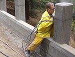 Hand sawing and beveling of retaining wall columns